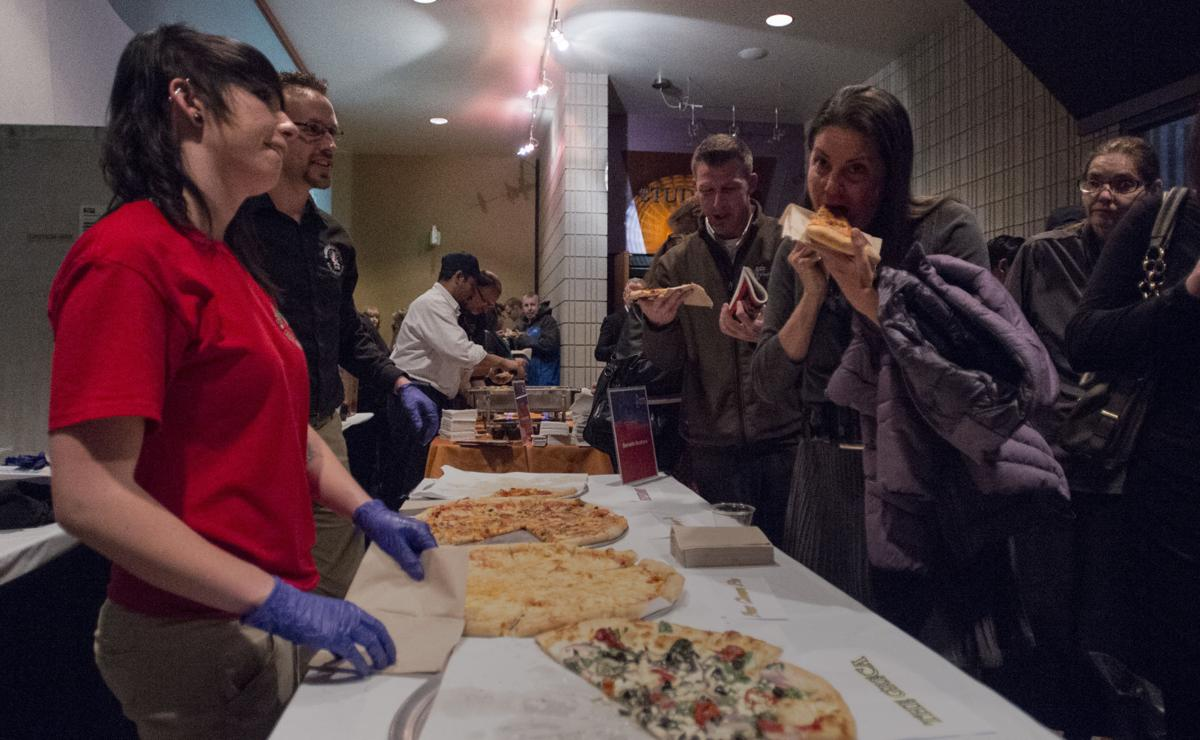 Guests sample pizza from Borriello Brothers Thursday, April 16, 2015, during the 2015 Best of the Springs launch party at The Pikes Peak Center. (The Gazette, Christian Murdock)