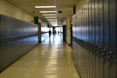 Student in empty hallway