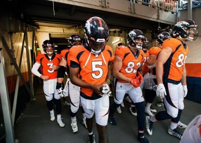 Broncos Bridgewater, team out of tunnel (copy)