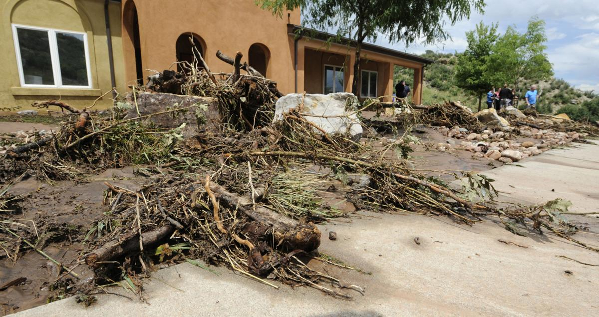 Debris from the Waldo Canyon Fire over three years ago, is strewn in front of the Alpine Autism Center. The center was flooded during Monday's deluge. All the children at the center were safely evacuated on Monday, August 10, 2015. (Jerilee Bennett/The Gazette)