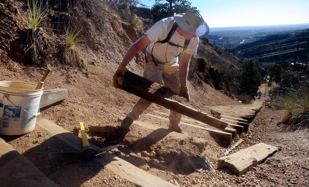 Charles Lindsey removes a rotten railroad tie Friday, April 8, 2011, while working on the Manitou Incline. ( The Gazette, Christian Murdock)