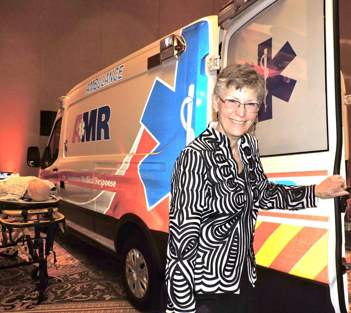 UCHealth Memorial Hospital Gala: Nancetta Westcott was ready to hop aboard at the AMR display. 042818 Photo by Linda Navarro