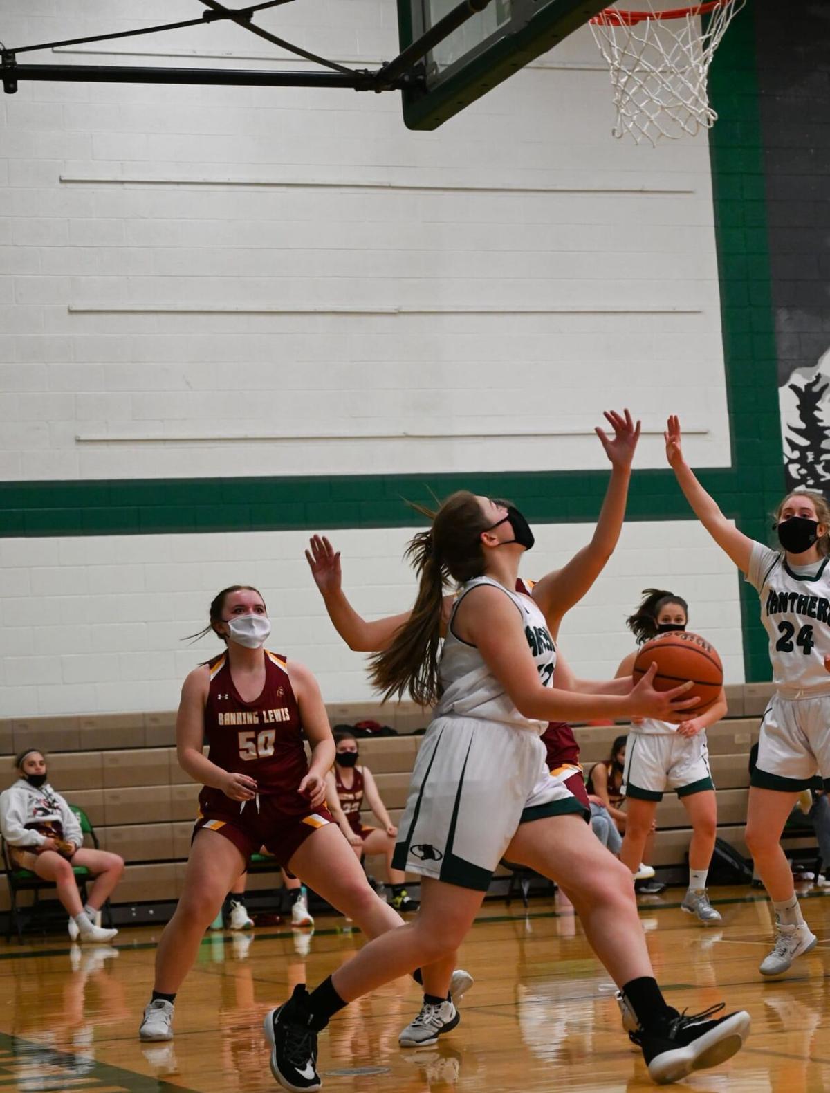Woodland Park girls' basketball triumph, boys fall short