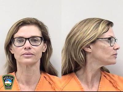 Former Colorado Springs councilwoman's charge of hurling knives at husband dropped