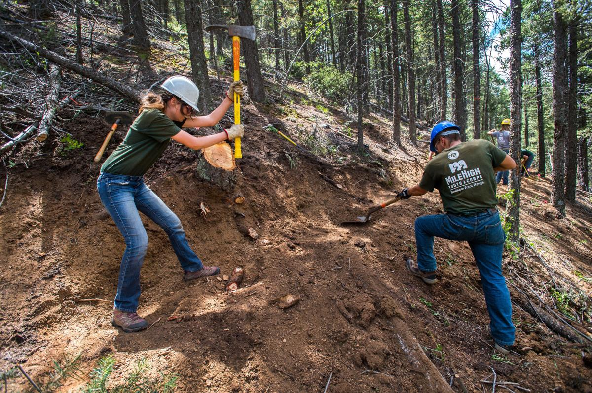 Cheyenne Cummings, left, and Trenton Bridwell of Mile High Youth Corp dig the route Thursday, July 22, 2016, of the new Mount Buckhorn connector trail between Trail 667 (Upper Captain Jack's) and the Bear Creek Trail along the north side of Mount Buckhorn. The youth corp was helping Rocky Mountain Field Institute build the trail. (The Gazette, Christian Murdock)