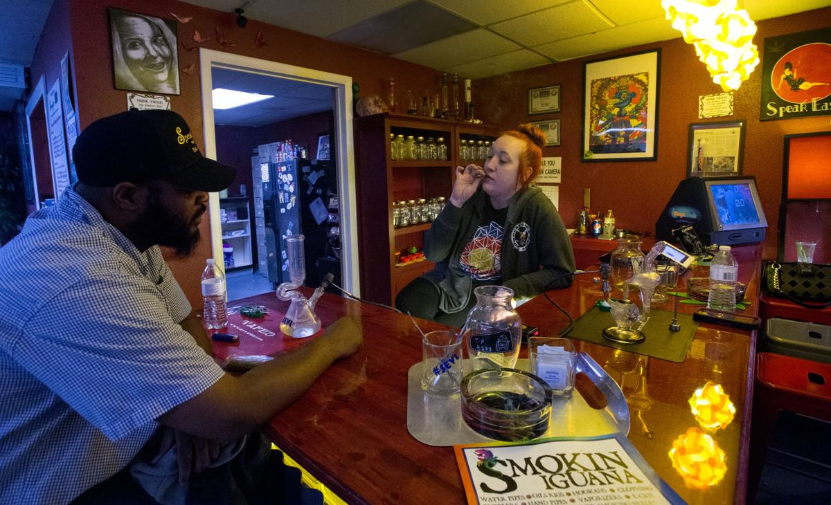 Emily McNamara smokes a joint with Black Angus Wednesday, March 16, 2016, at the Speakeasy Vape Lounge and Cannabis Club in Colorado Springs. The Marijuana club was been open for three years. (The Gazette, Christian Murdock)
