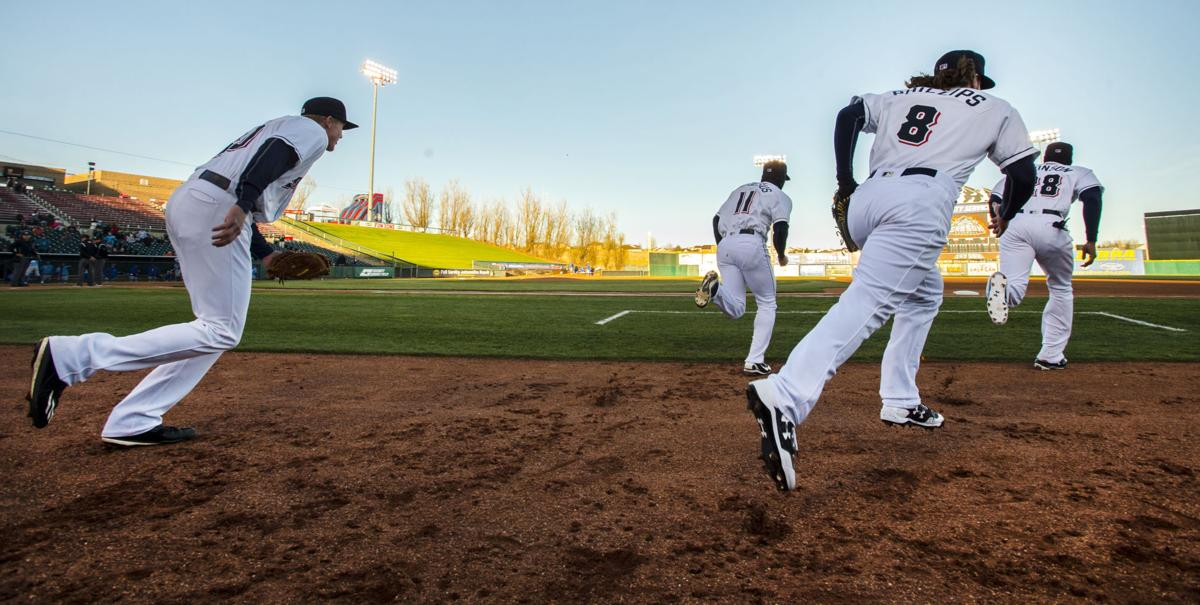 The Sky Sox team runs onto the field for the start of their 2017 season Thursday, April 6, 2017, at Security Service Field in Colorado Springs, Colo. The Sky Sox played the Omaha Storm Chasers. (The Gazette, Christian Murdock)