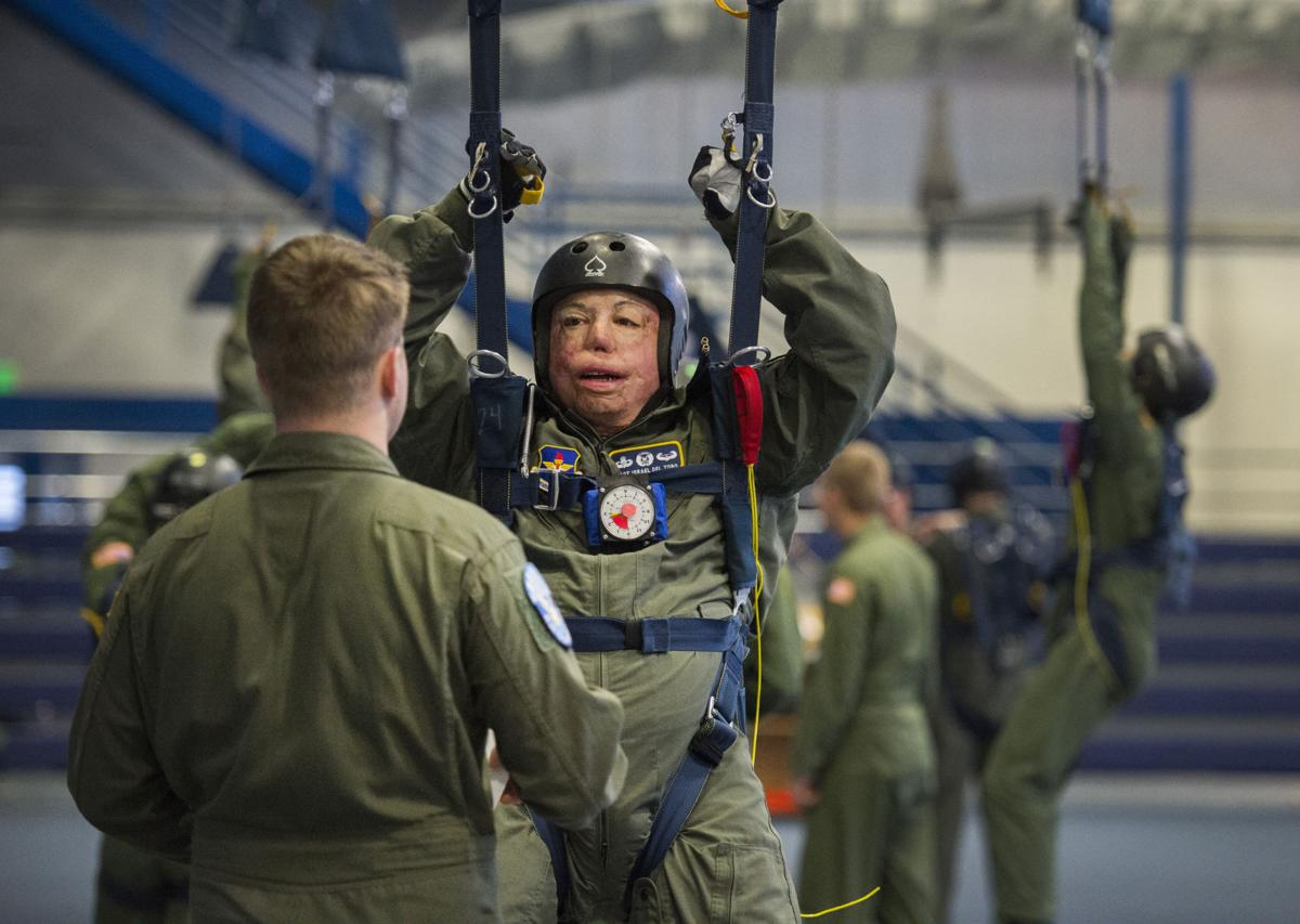 Master Sgt. Israel Del Toro listens to cadet instructor Jordan Wesemann while taking the jumping course Wednesday, Feb. 15, 2017, at the parachute training center on Air Force Academy. Del Toro was severely burned in a roadside bomb blast in Afghanistan in December 2005. He reenlisted in 2010 after being 100 percent medically discharged and Saturday he jump for the first time since his injury.  (The Gazette, Christian Murdock)
