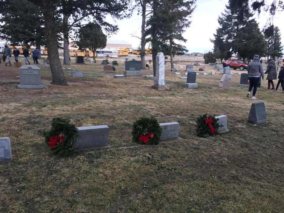 Wreaths honor the memories of military service members lying in rest at Monument Cemetery