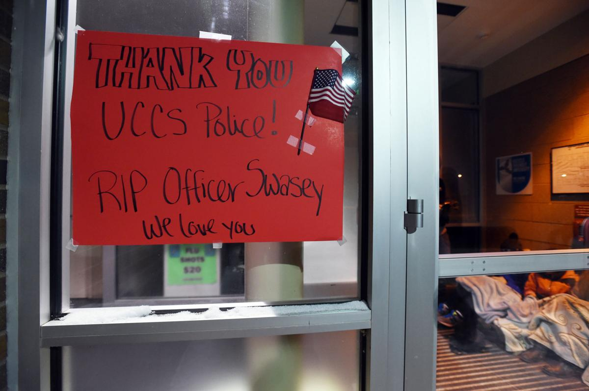 A sign was taped to the door of the Public Safety office at the University of Colorado at Colorado Springs in honor of Officer Garrett Swasey on Friday, November 27, 2015. Officer Swasey, 44, responded in support of Colorado Springs Police to the active shooter situation at the Planned Parenthood building on He was killed in the line of duty. .JERILEE BENNETT/THE GAZETTE