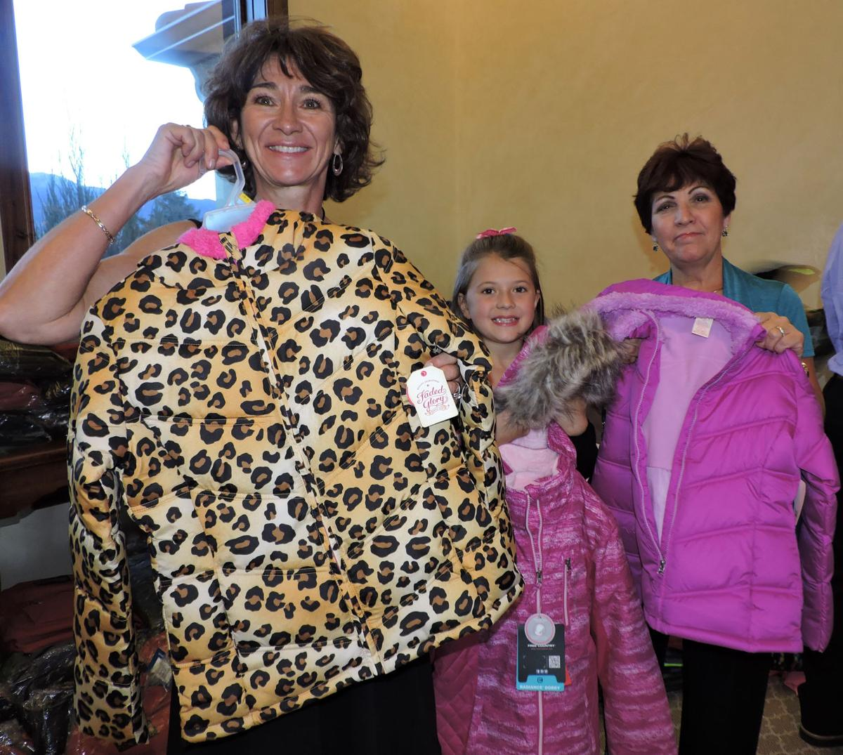 Koats 4 Kids donations: from left, Mary Ann Arkfeld, Maddy Fish and Maryann Krause. 102116 Photo by Linda Navarro