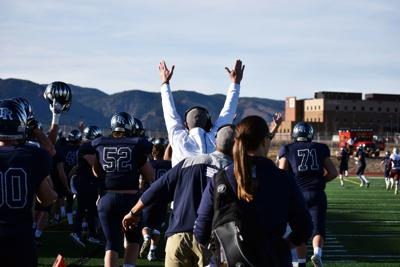 Palmer Ridge coaches signal touchdown as Deuce Roberson returns a kickoff to the endzone to give the Bears a lead during a 3A football semfinal game against Palisade on Saturday, November 25, 2017 at Don Breese Stadium. The Bears' defeated the Bulldogs 28-14 for their first-ever trip to the state championship. (Lindsey Smith, The Gazette) (copy)