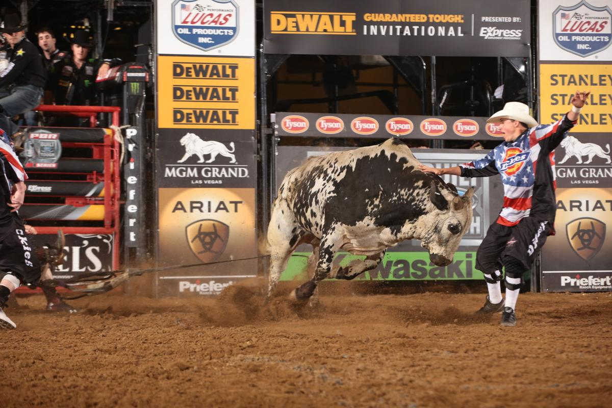 Stetson Lawrence attempts to ride Bird Bucking Bulls's War Party during the first round of the Nampa Built Ford Tough series PBR. Photo by Andy Watson.