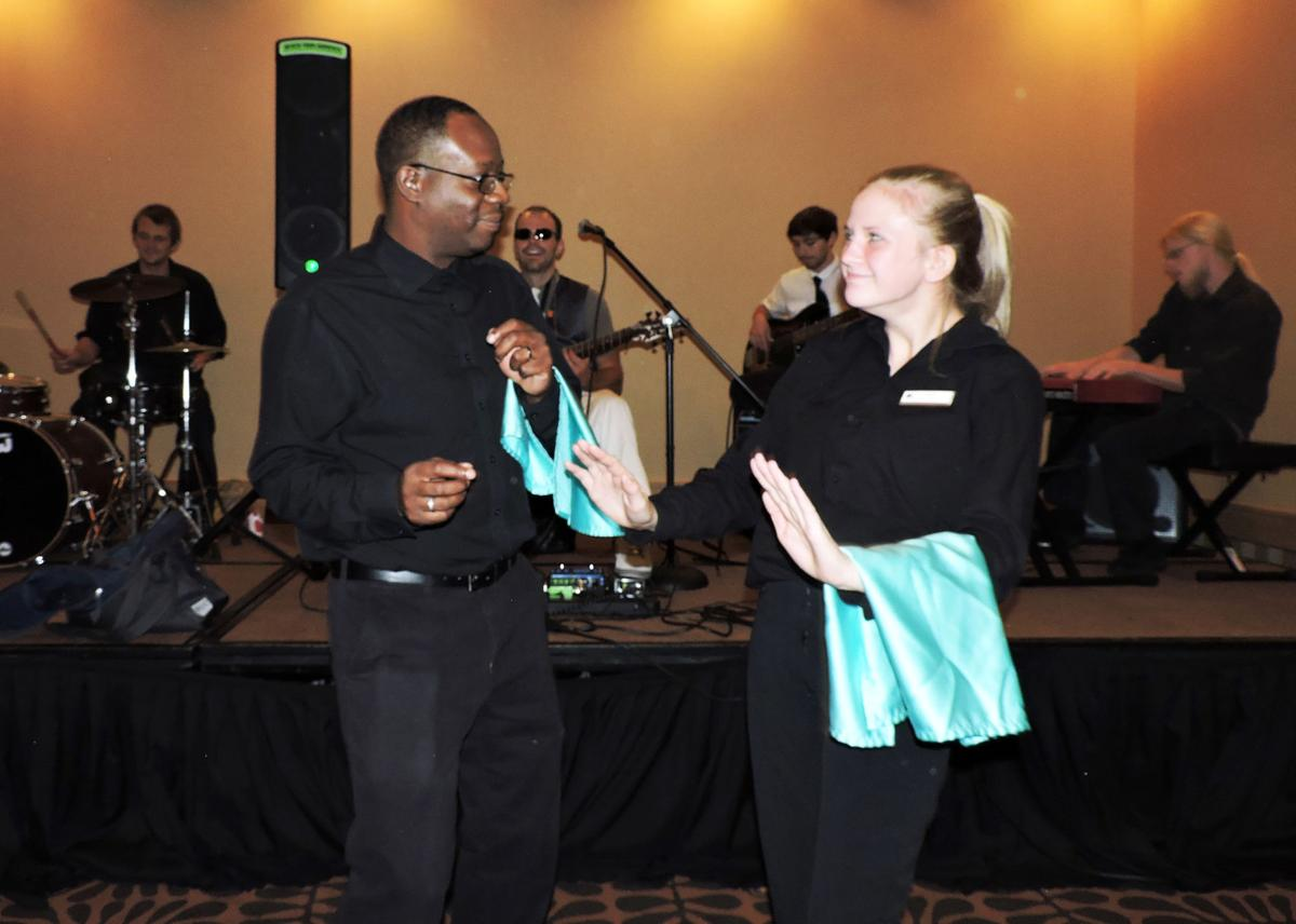 Before the ADA luncheon crowd came in at the Doubletree Hotel, servers Tyrone Sherman and Paige Groninger moved to the beat of Jorden Smith and A Positive Note as they warmed up. 072616 Photo by Linda Navarro
