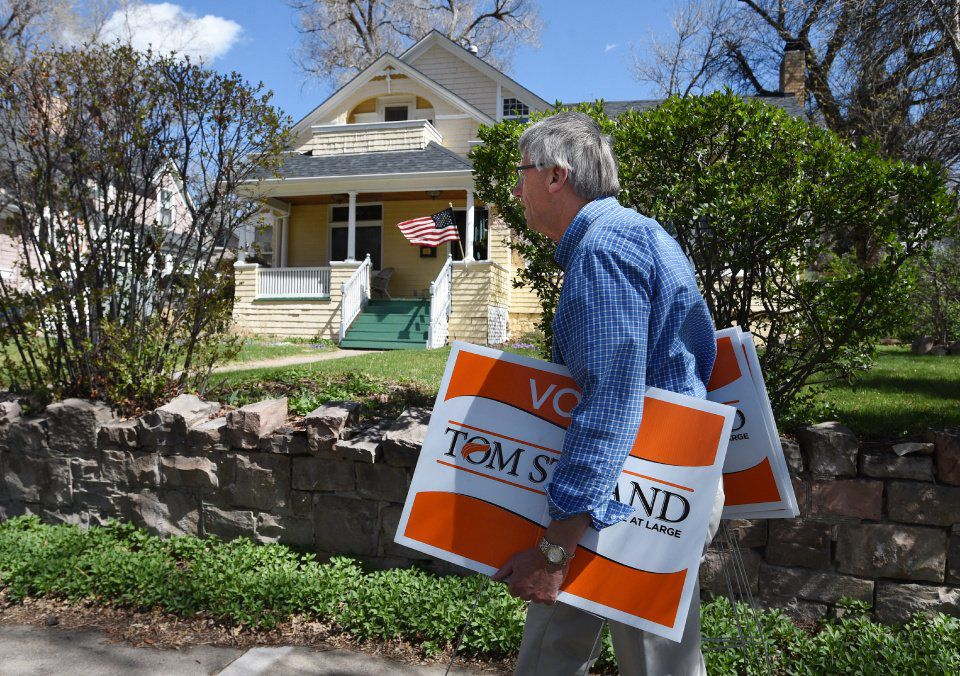Tom Strand was elected to be as a first time councilman in Colorado Springs as an at large candidate. The day after the election he collects election signs from his neighbors' yards in historical Old Colorado City on Wednesday, April 8, 2015. (JERILEE BENNETT/THE GAZETTE)