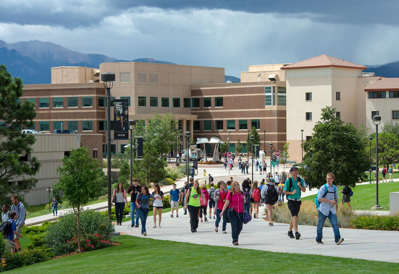 Students walk on the University of Colorado at Colorado Springs campus Thursday, Aug. 28, 2014 during their first week of the fall semester. Enrollment at the Colorado Springs university has increased 40 percent over the last decade to 11,199. (The Gazette, Christian Murdock)