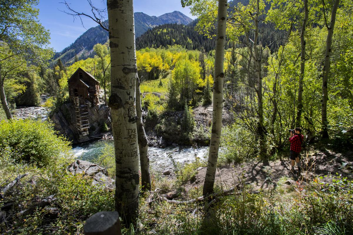 A photographer takes a picture of the Crystal Mill as the aspens begin to turn near Marble, Colo., Tuesday, Sept. 19, 2017. See Monday's Life Section in The Gazette for the story behind the most photogenic scene in Colorado and see this Sunday's Life for a gallery of the turning aspens. (The Gazette, Christian Murdock)