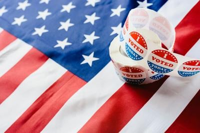I vote today stickers roll, in US elections on American flag. (copy) (copy)