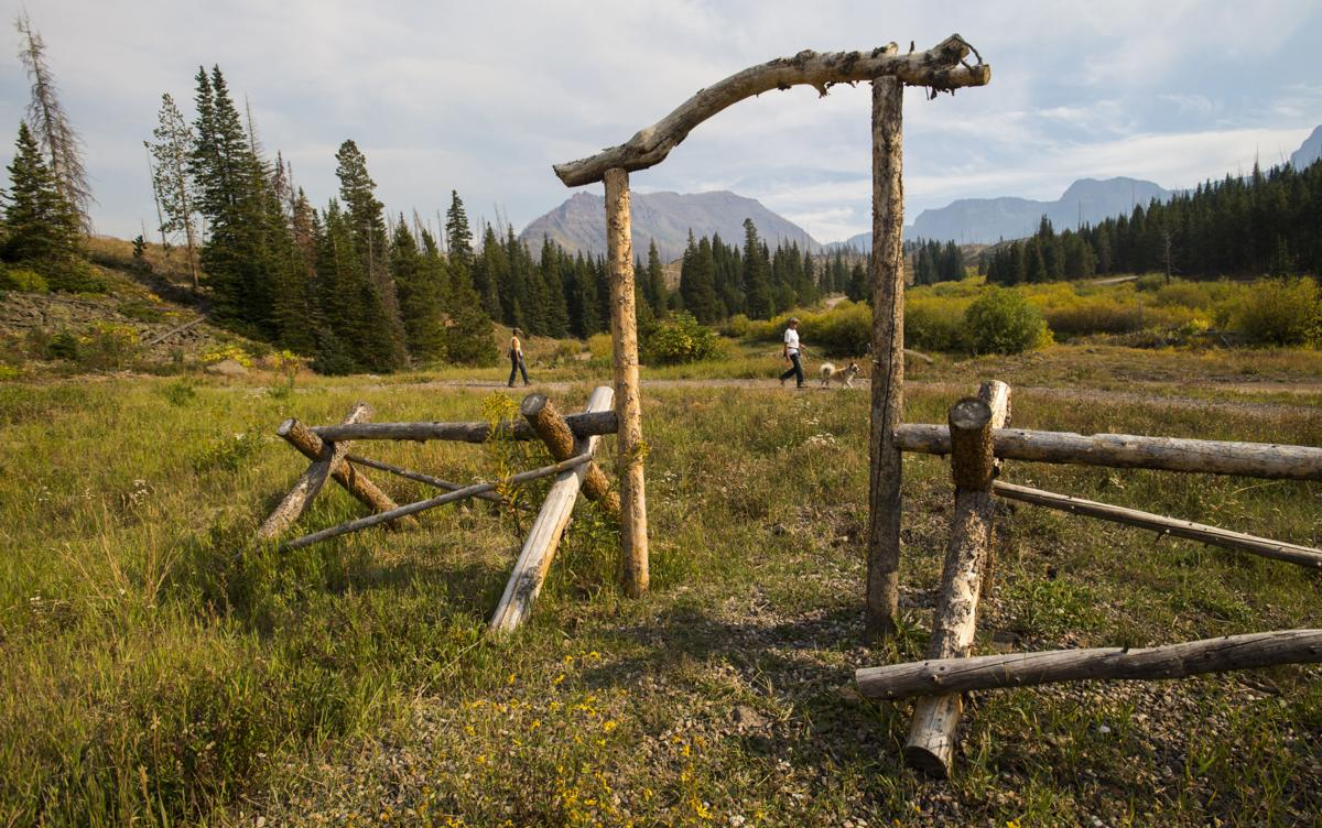 A wedding arbor frames visitors as they go for an evening hike Wednesday, Sept. 7, 2016, at Trappers Lake Lodge in northwest Colorado. (The Gazette, Christian Murdock)
