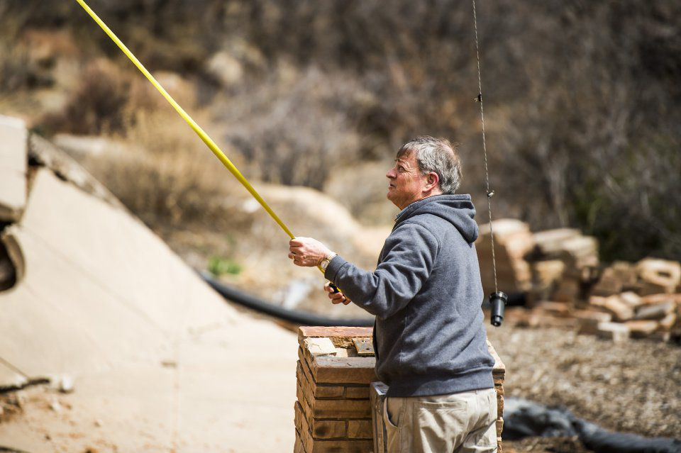 Landslides - Rick Sisco measures how much his property has fallen