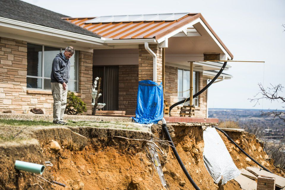 Landslides - Rick Sisco stands at the now edge of his property