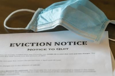 Official legal eviction order or notice to renter or tenant of home with face mask (copy)