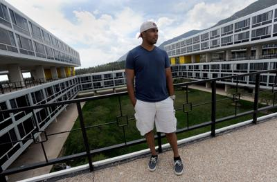 Former Air Force Cadet Eric Thomas stands outside the cadet dorms Tuesday, May 28, 2013, the day before the Class of 2013 graduates at the Air Force Academy. Thomas, who was a confidential imformant and critical to several convictions, was kicked out of the academy in March, months short of graduating. (The Gazette, Christian Murdock)