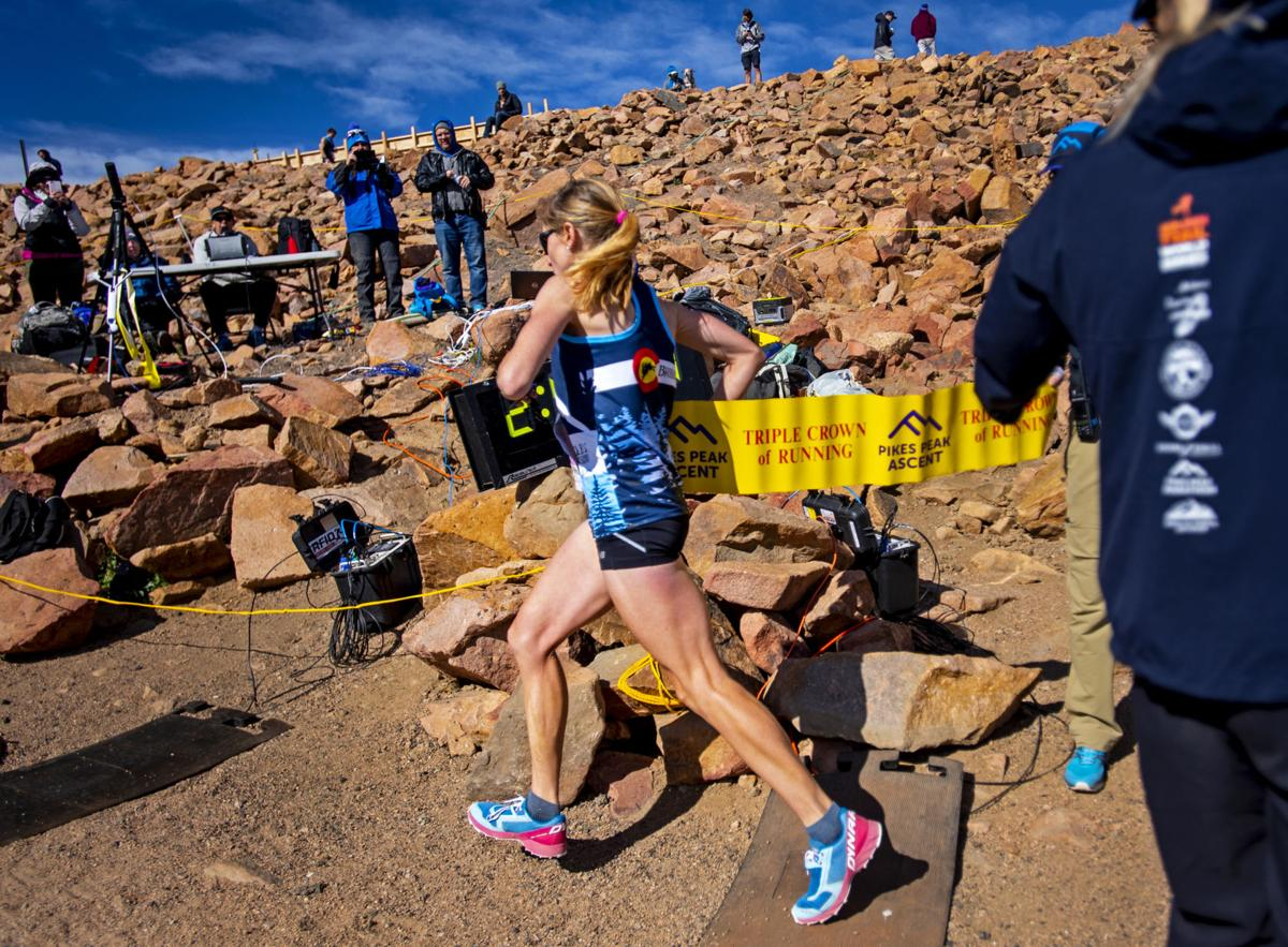 Racers compete in the 64th Pikes Peak Marathon and Ascent