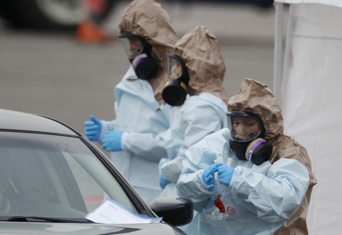 PRINT: Virus screenings jam US airports; 'atrocious,' a flyer says (copy)