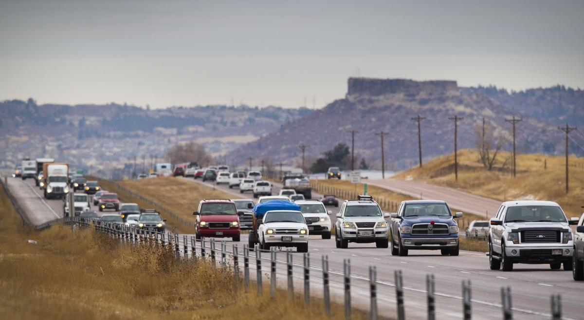 heavy traffic moves along Interstate 25