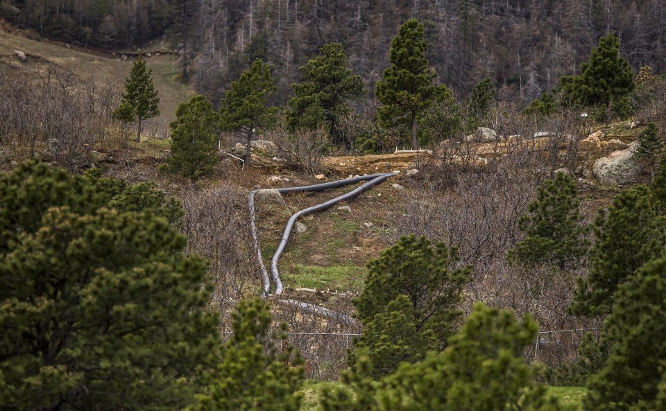 Landslides - New water pipes flank Judith Myklak's house