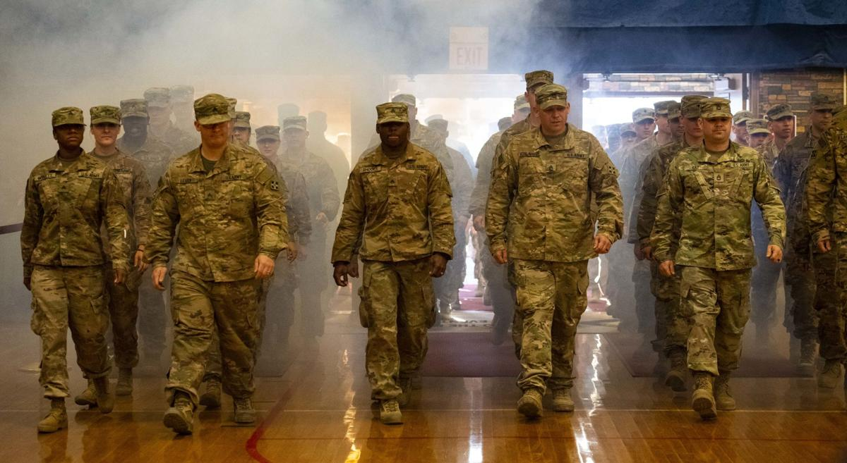 Families welcome Fort Carson soldiers home
