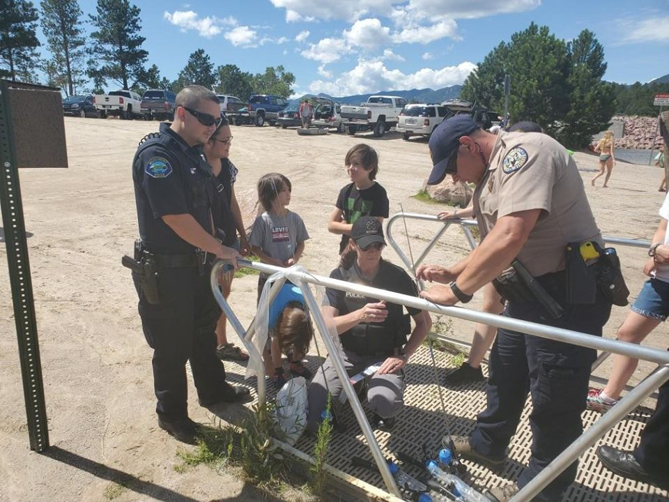 Special Olympians try their hands at fishing with a cop