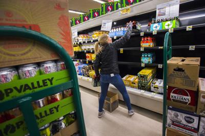 Becca Peterson of MillerCoors stocks the cooler at Safeway