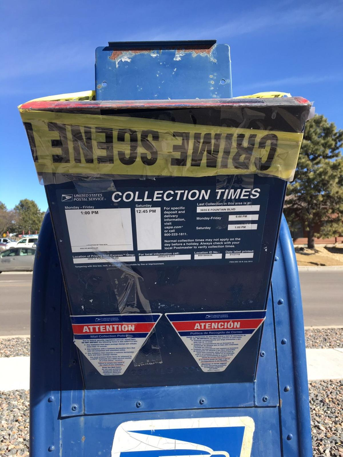 Crime Scene tape-covered cardboard fastened to two out-of-service mailboxes have Rockrimmon