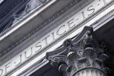 Courthouse close with Justice inscribed