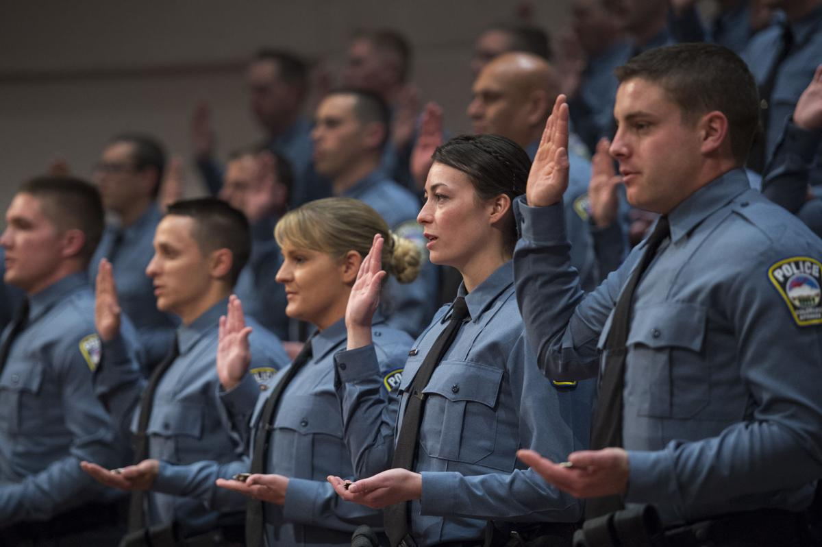 The 36 police officers from the 66th police class at the Colorado Springs Police Department Training Academy take their oaths of office Friday, April 14, 2017, during the graduation ceremony at the Village Seven Presbyterian Church for the 66th police class at the Colorado Springs Police Department Training Academy.  (The Gazette, Christian Murdock)