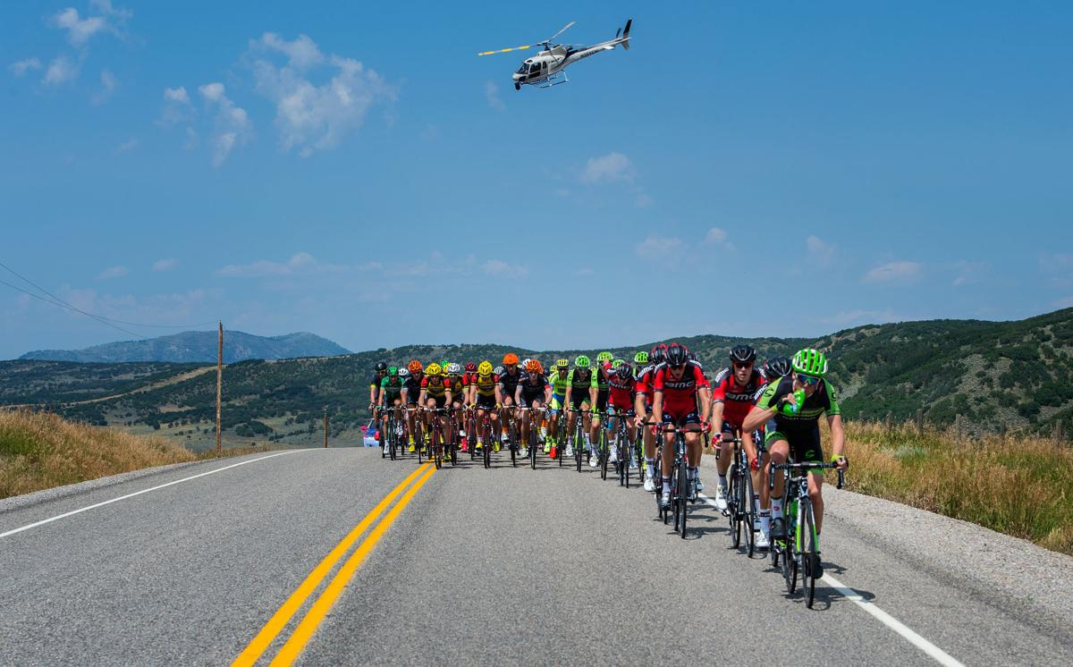 The peloton races through the backs roads outside Steamboat Springs Monday, Aug. 17, 2015, during Stage 1 of the 2015 USA Pro Challenge in Steamboat Springs, Colo. Stage 1 is a two-lap, 97 miles circuit beginning and ending in Steamboat Springs. (The Gazette, Christian Murdock)