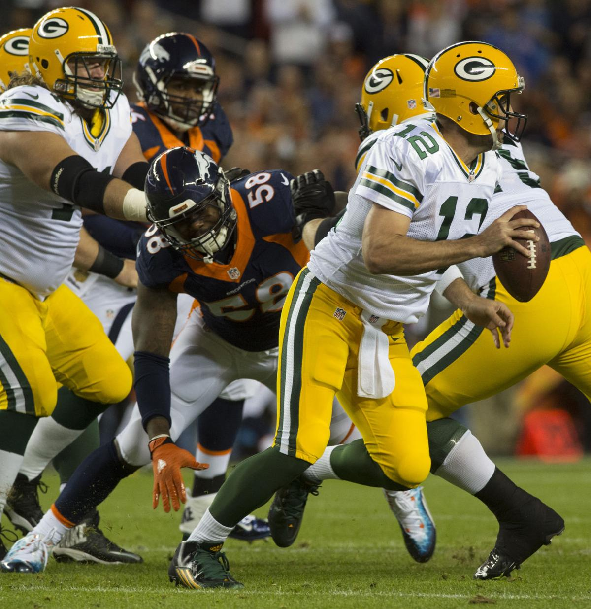 Denver outside linebacker Von Miller chases Green Bay quarterback Aaron Rodgers during the first quarter Sunday, Nov. 1, 2015, at Sports Authority Field at Mile High in Denver. (The Gazette, Christian Murdock)