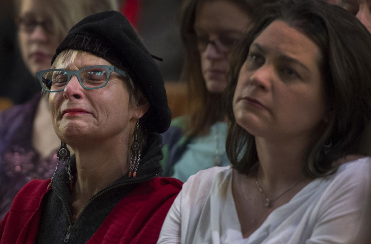 Lynn Young begins to cry Saturday, Nov. 28, 2015, during a vigil at the All Souls Unitarian Universalist Church in downtown Colorado Springs for the three killed in the shooting at the Planned Parenthood clinic Friday, Nov. 27, 2015. (The Gazette, Christian Murdock)