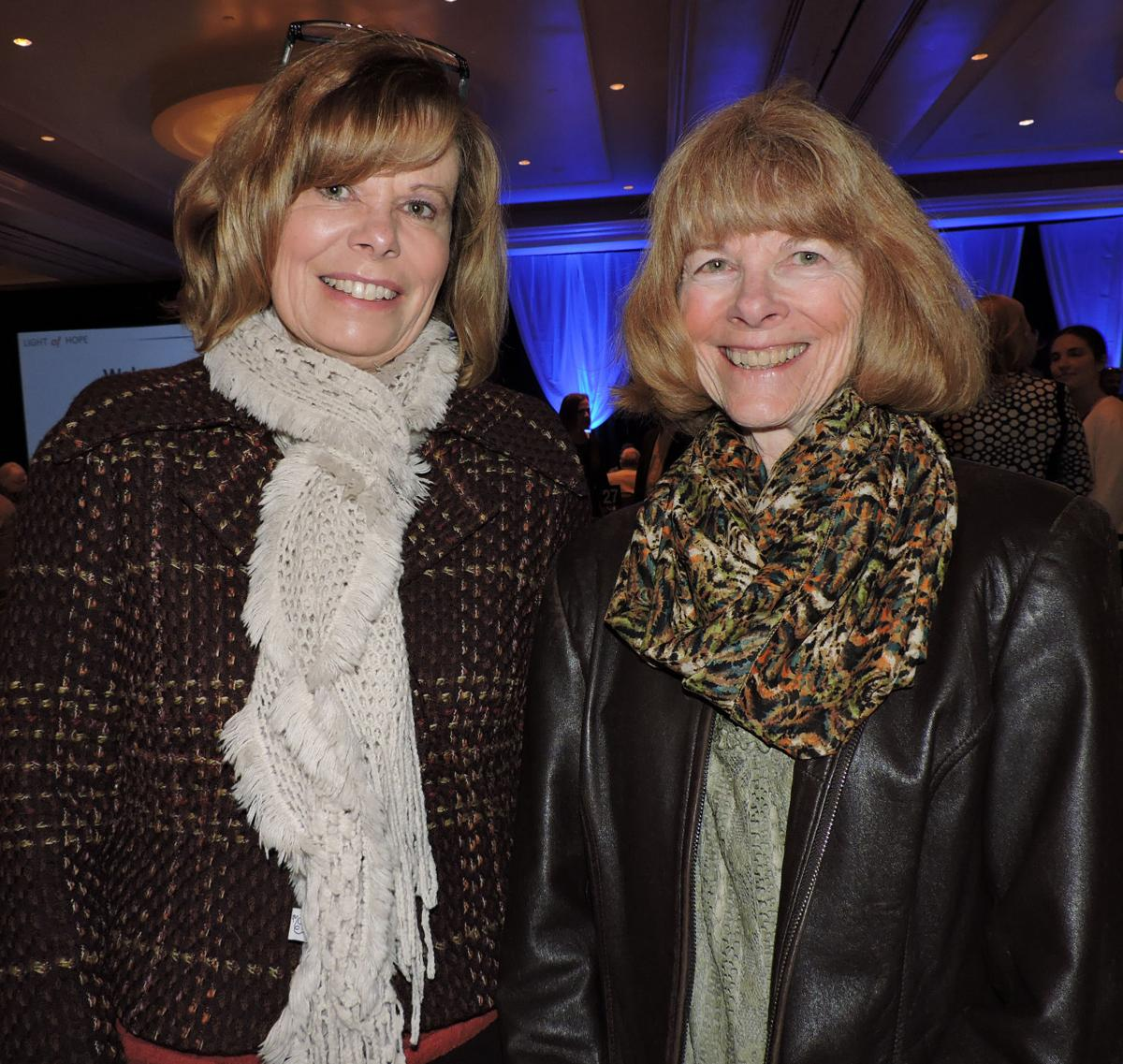 CASA Light of Hope breakfast: Monica Ramey, left, chats with Ute Pass Courier writer Pat Hill. 042518 Photo by Linda Navarro