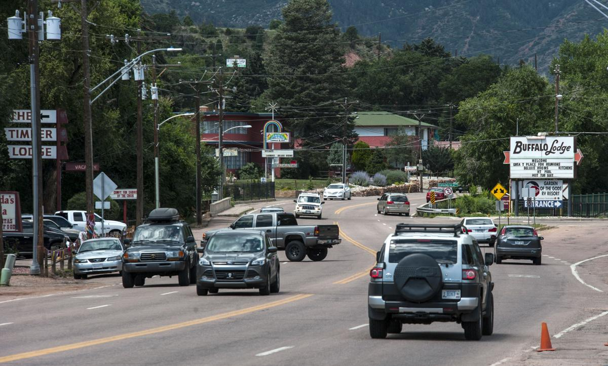 """Traffic drives along Colorado Avenue Saturday, July 27, 2014, between Colorado Springs and Manitou Springs in an area called """"no man's land."""" (The Gazette, Christian Murdock)"""