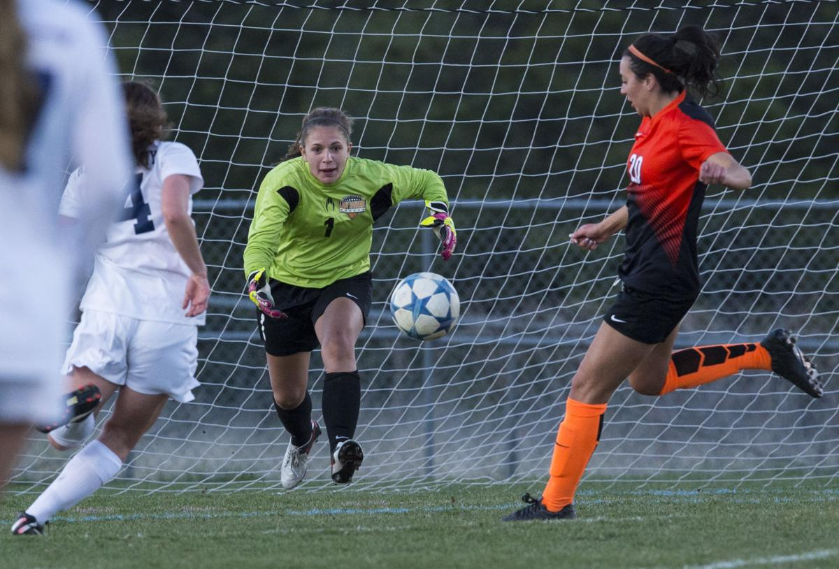 Lewis-Palmer goalkeeper Haley Arsenault makes a save against Air Academy Tuesday, May 3, 2016, during the second half at Air Academy High School. Lewis-Palmer won 1-0. (The Gazette, Christian Murdock)