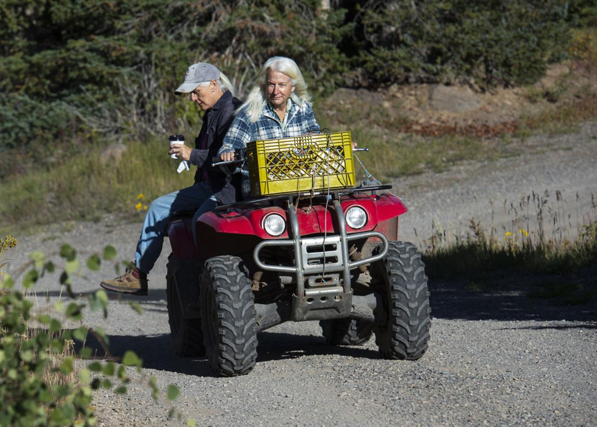 Co-owners and sisters Holly King, front, and Carol Steele ride their ATV back to the lodge after feeding the horses Thursday, Sept. 8, 2016, at Trappers Lake Lodge in northwest Colorado. (The Gazette, Christian Murdock)