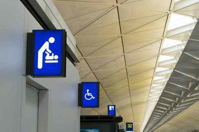Illuminated signboard for deaper changing rooms and disabled toi