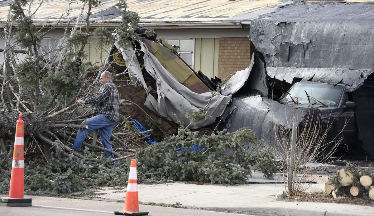 Hurricane force gusts down trees, topple trucks and prompt outages