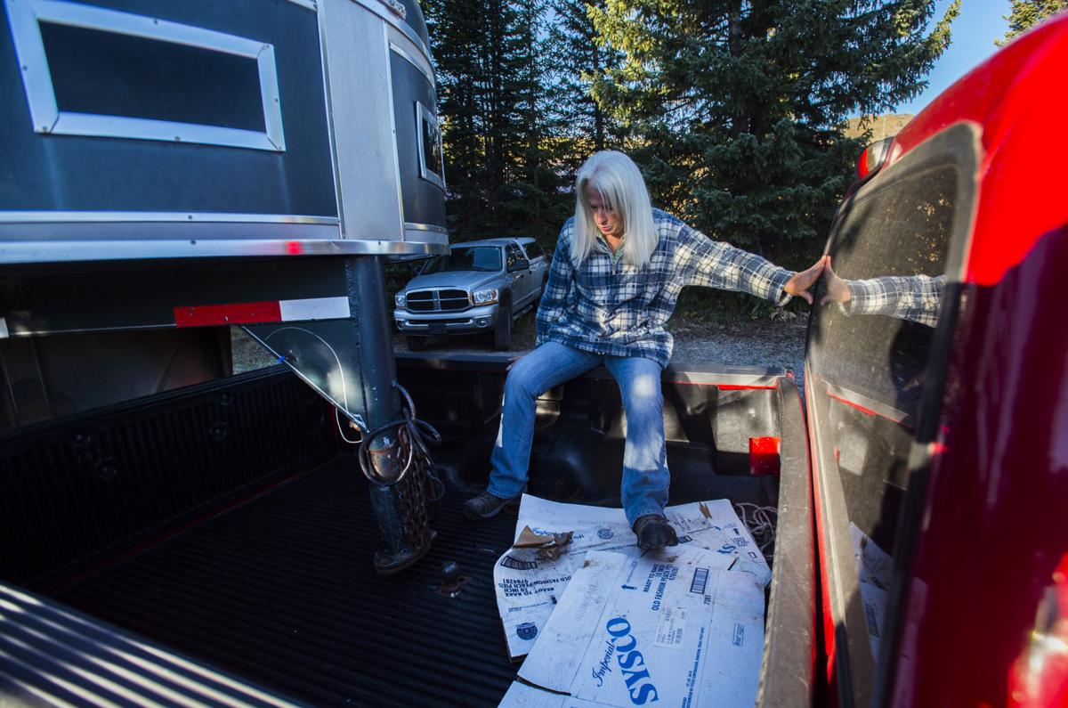 Co-owner Holly King helps her sister, Carol Steele, attach the horse trailer at Trappers Lake Lodge in northwest Colorado Thursday morning, Sept. 8, 2016, before guiding a group into the Flat Tops Wilderness Area. (The Gazette, Christian Murdock)