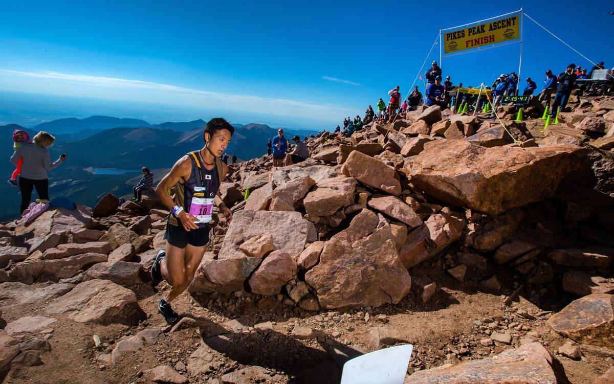Touru Miyahara of Japan rounds the final corner to win the 2015 Pikes Peak Ascent Saturday, Aug. 15, 2015, on the top of 14,115-foot Pikes Peak. The 13.2-mile race begins in Manitou Springs and follows Barr Trail to the top of the mountain. (The Gazette, Christian Murdock)