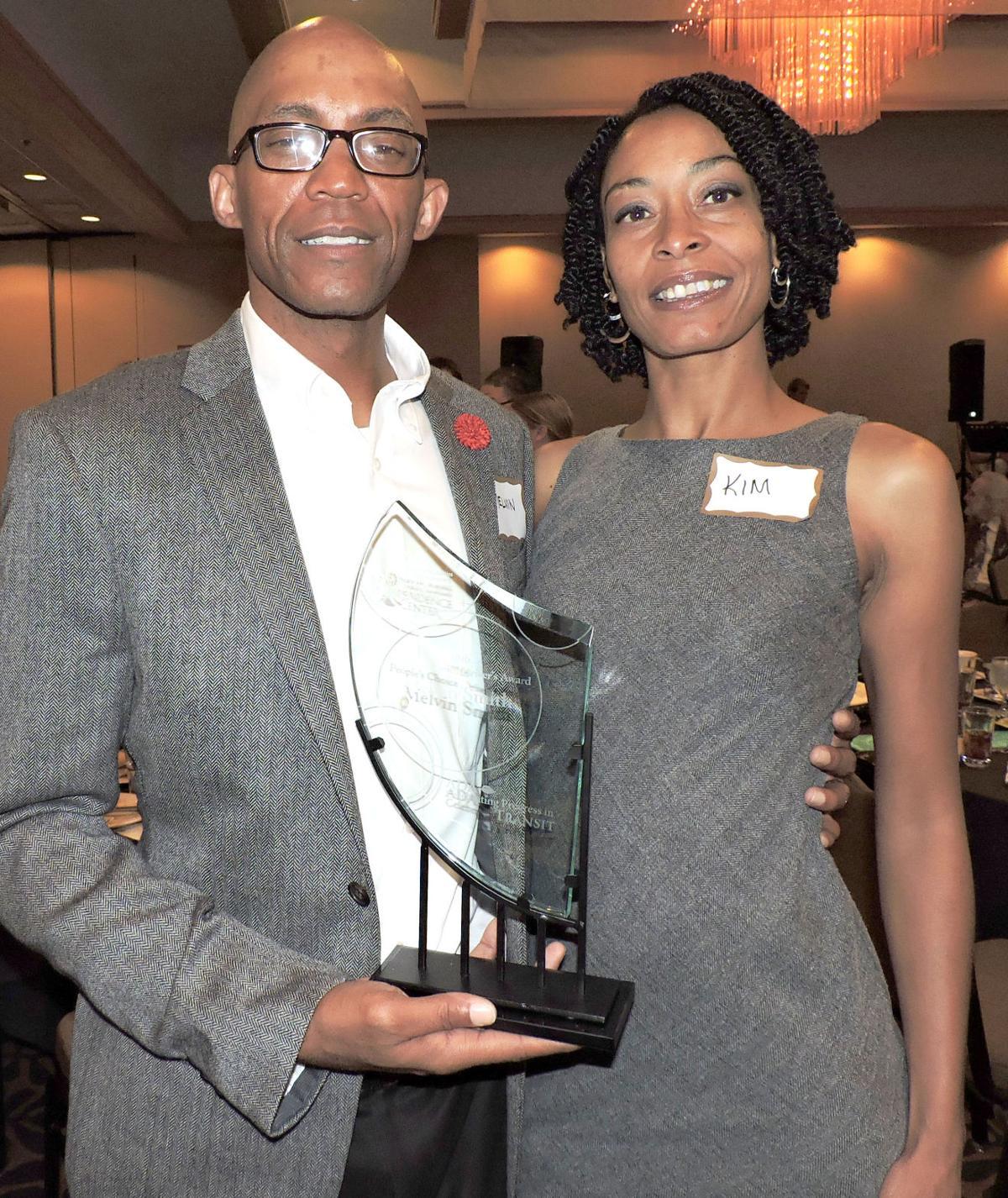 People's Choice Driver's Award recipient Melvin Smith, Amblicab, and wife Kim. 072616 Photo by Linda Navarro