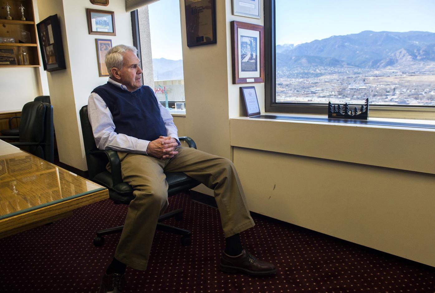 Developer Steve Schuck looks out his office window on the 12th floor of the 1st Bank Building in downtown Colorado Springs Friday, March 4, 2017. Schuck envisioned southeast Colorado Springs becoming a gateway to the city's airport and an industrial and research and development hub when he started building in the area. (The Gazette, Christian Murdock)